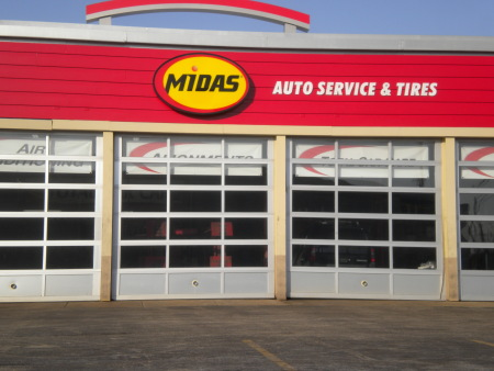 Photo of a car repair shop, showing the large overhead doors of the garage.